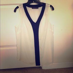 Sleeveless offwhite and black vneck shirt
